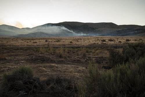 Chris Detrick  |  The Salt Lake Tribune Fire burns west of Utah Lake and south of Saratoga Springs along State Road 68 Thursday May 31, 2012. No homes or structures have been threatened as of Thursday evening.