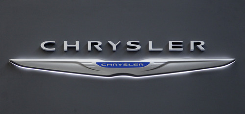 This Feb. 16, 2012 photo shows Chrysler logo on the Chrysler exhibit at the 2012 Pittsburgh Auto Show. Chrysler says its U.S. sales rose 30 percent and sold more than 150,000 vehicles in May, compared with 115,000 in the same month a year ago. (AP Photo/Gene J. Puskar, File)