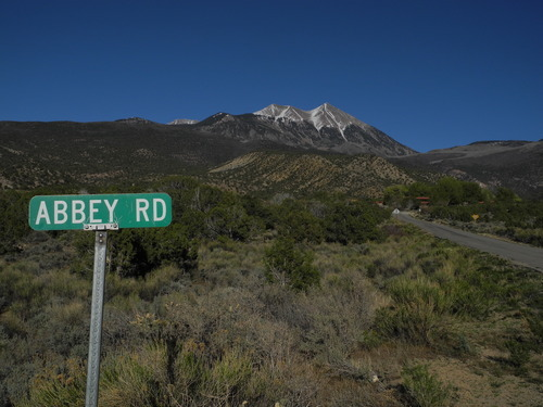 Stephen Speckman | Special to The Salt Lake Tribune Abbey Road, named after late eco-activist Edward Abbey, marks one of the turnoffs before Ken and Jane Sleight's home at Pack Creek Ranch, seen in the distance below Mount Peale.
