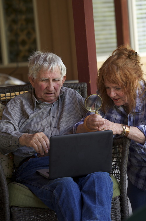 Stephen Speckman | Special to The Salt Lake Tribune SPLORE founder Martha Ham shows retired river guide Ken Sleight, 82, a digital copy of a June 15, 1960, entry into a registry with his name on it that commemorated taking Boy Scout Troop 220 to Music Temple, an area now under water because of the Glen Canyon Dam.