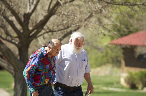 Stephen Speckman | Special to The Salt Lake Tribune Friends Art Gallenson (left) and Art Fenstermaker, both retired river guides, walk back to Ken Sleight's cabin at Pack Creek Ranch in Moab after talking to SPLORE founder Martha Ham, who is documenting their stories for donation to the University of Utah's Marriott Library.