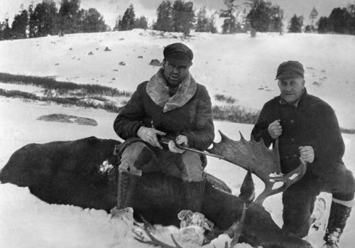 Jack Dempsey, the former heavyweight champion is atop a 1200-pound moose he killed during one of his hunts in Wyoming on Nov. 1, 1931. With him is Harry Johnson, a Salt Lake City sportsman. (AP Photo)