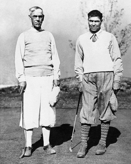 Jack Dempsey, who has been the subject of many rumors, both pro and con, photographed at Salt Lake City, on Nov. 4, 1931 when he played a round of golf with Senator Reed Smoot. The senator won by four strokes, but Dempsey explained that it was his first game in three years. (AP Photo)