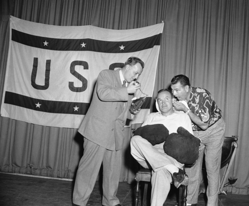 Jim Bacon, Associated Press writer, and Jack Dempsey work over Bob Hope between rounds at Hope?s TV rehearsal, Oct. 11, 1957. (AP Photo/Ed Widdis)