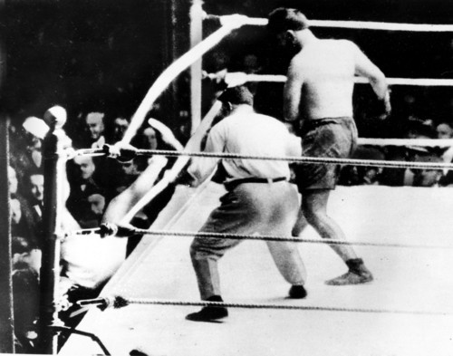 Jack Dempsey falls through the ropes during the heavyweight fight against Luis Firpo at the Polo Grounds in New York City on Sept. 14, 1923.  Dempsey retained his title in a second round knockout against the