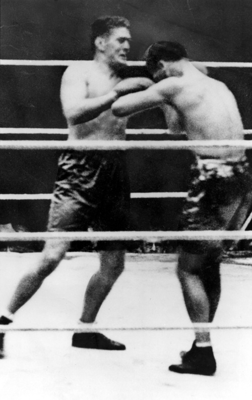 Challenger Gene Tunney, left, holds off Jack Dempsey during their heavyweight title match in Philadelphia's Sesqui-Centennial Stadium on Sept. 23, 1926.  Tunney won the decision to capture the world heavyweight title from Dempsey.  (AP Photo)