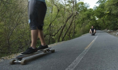 Leah Hogsten  |  The Salt Lake Tribune Longboarders on the Provo River Parkway near Nunn's Park campground Tuesday, May 29 2012 in Provo.
