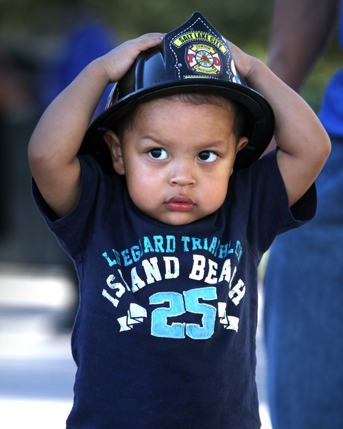 Rick Egan  | The Salt Lake Tribune   Two-year-old Lionel Huerta, tries on his fire hat at the safety fair at Fire Station #7, near the Utah State Fairgrounds, Friday, June 1, 2012.