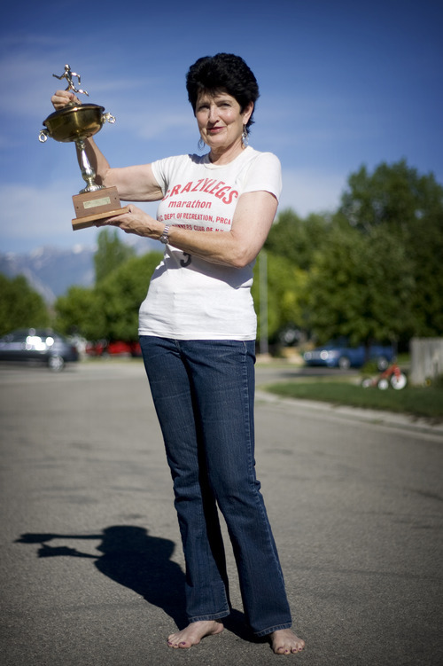 Kim Raff | The Salt Lake Tribune Jacki Dixon, of West Jordan, was the first woman to win the first woman's long-distance race in 1972, known as the Mini. She was 17 at the time. This is the 40th anniversary of the Mini, which is a 10k race for women through NYC's Central Park. She is photographed with the trophy she won and the shirt she competed in during the race.
