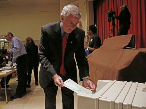 Wisconsin Democratic gubernatorial candidate Tom Barrett puts his ballot into a machine after voting Tuesday, June 5, 2012, in Milwaukee. Barrett is facing Republican Wisconsin Gov. Scott Walker in a recall election. (AP Photo/Jeffrey Phelps)
