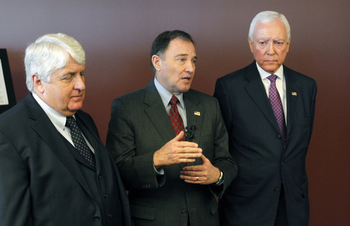 Al Hartmann  |  Tribune file photo Rep. Rob Bishop, left, Utah Sen. Orrin Hatch and Gov. Gary Herbert speak at the opening of the ICBM Building at Hill Air Force Base in October 2008. Herbert endorsed Hatch for re-election on Wednesday, June 6, 2012.