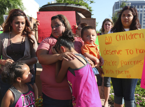 Lennie Mahler     The Salt Lake Tribune Laura Avelar comforts her niece, Abigail, during a press conference held north of the LDS Temple with family and friends of the Avelars on Monday, June 4, 2012. The Avelar sisters face deportation June 15 that would split their families.