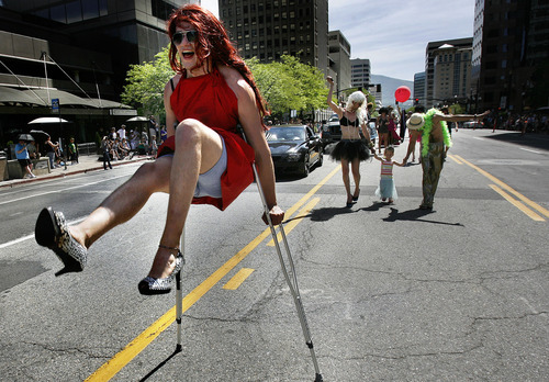 Scott Sommerdorf  |  The Salt Lake Tribune              Josh Bagley parades on crutches and heels during the annual Gay Pride Parade through downtown Salt Lake City, Sunday, June 3, 2012.