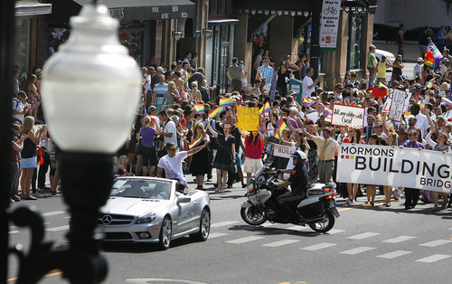 Scott Sommerdorf  |  The Salt Lake Tribune              Grand Marshal Dustin Lance Black leads the annual Gay Pride Parade through downtown Salt Lake City followed by the Mormons Building Bridges group right behind, Sunday, June 3, 2012.