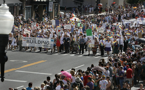 Scott Sommerdorf  |  The Salt Lake Tribune              Mormons Building Bridges group leads the annual Gay Pride Parade through downtown Salt Lake City, Sunday, June 3, 2012.