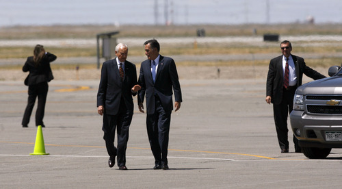 Francisco Kjolseth  |  The Salt Lake Tribune Republican presidential candidate Mitt Romney, center right, arrives in Salt Lake City on Friday, June 8, 2012, for a campaign stop and to raise funds for Sen. Orrin Hatch.