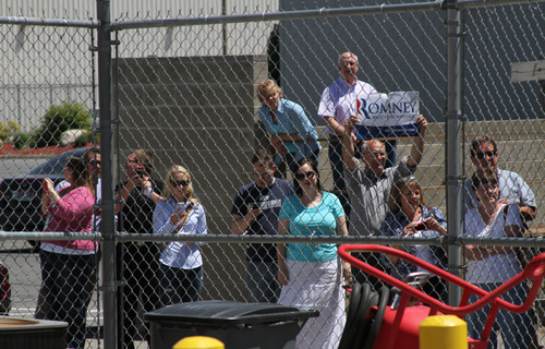 Francisco Kjolseth  |  The Salt Lake Tribune A few people wait to greet Republican presidential candidate Mitt Romney arriving in Salt Lake City on Friday, June 8, 2012. Romney is in Salt Lake for a campaign stop and to raise funds for Sen. Orrin Hatch.