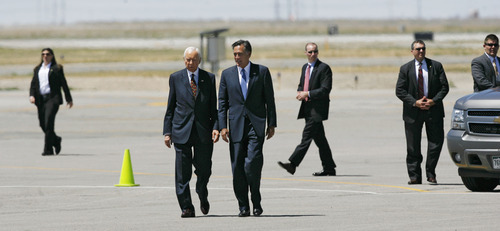 Francisco Kjolseth  |  The Salt Lake Tribune Sen. Orrin Hatch, center left, welcomes Republican presidential candidate Mitt Romney as he arrives in Salt Lake City on Friday, June 8, 2012, for a campaign stop and to raise funds for Hatch.