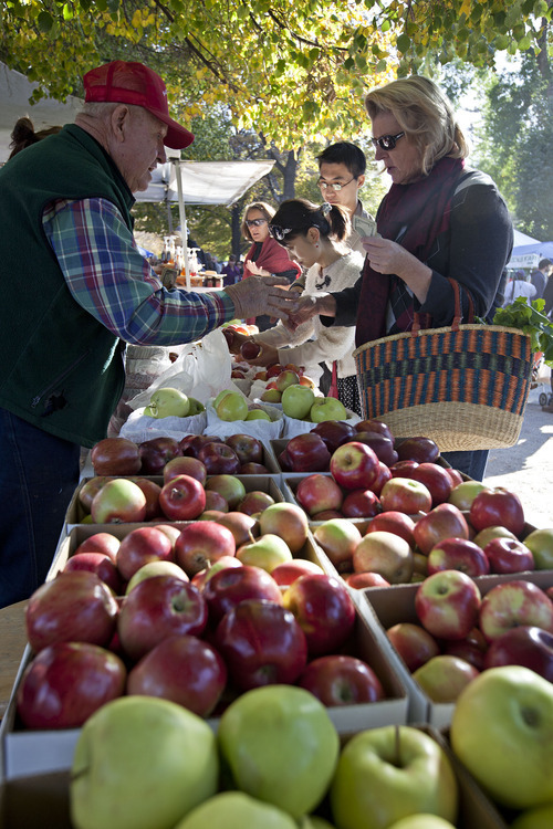Lennie Mahler  |  Tribune file photo Vendors sell fruit at the 2011 Downtown Farmers Market. This year's market kicks off Saturday at Pioneer Park.