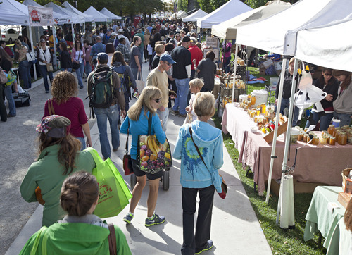 Lennie Mahler  |  Tribune file photo Shoppers stroll around the 2011 Downtown Farmers Market. This year's market kicks off Saturday at Pioneer Park.