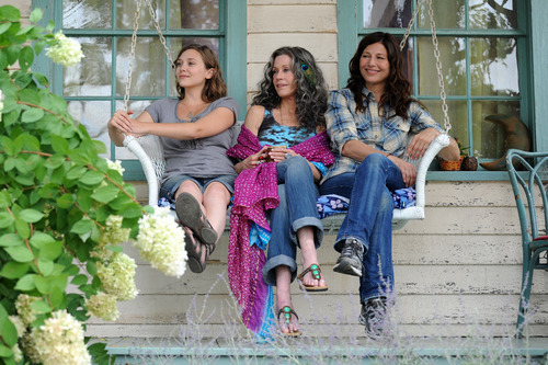 This image released by IFC Films shows Elizabeth Olsen, left, Jane Fonda and Catherine Keener in a scene from