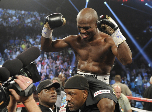 Timothy Bradley, from Palm Springs, Calif., reacts to his split decision victory over Manny Pacquiao, from the Philippines, in their WBO welterweight title fight Saturday, June 9, 2012, in Las Vegas. (AP Photo/Chris Carlson)