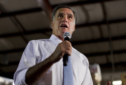 (AP Photo/Evan Vucci) Republican presidential candidate Mitt Romney has given the tax-hike claim a different twist, applying it to President Barack Obama's budget proposal for next year.