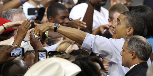 President Barack Obama, here greeting supporters during a campaign rally at Virginia Commonwealth University in Richmond, Va., Saturday, May 5, 2012, is counting on again carrying overwhelming black support to win re-election this fall. (AP Photo/Steve Helber)