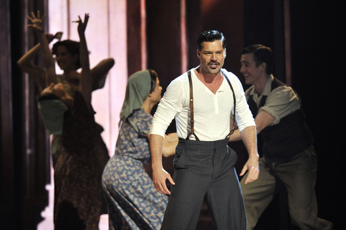 Ricky Martin performs with the cast of