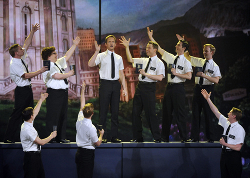 Host Neil Patrick Harris performs with the cast of