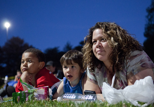 Michael Mangum  |  Special to the Tribune  Holladay resident Martha Gladue, right, and her sons Peyton, 4, center, and Roman, 8, lay on the grass and watch