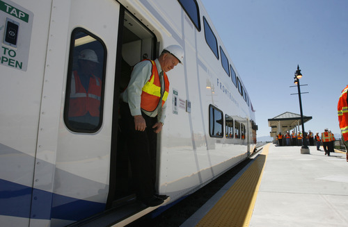 Francisco Kjolseth  |  The Salt Lake Tribune Getting a glimpse inside, Lehi Mayor Bert Wilson steps off the the first FrontRunner train that arrived in Utah County at the Lehi Station on Monday, June 11, 2012, marking the beginning of the testing process of the new commuter rail line that links Provo to Salt Lake City.