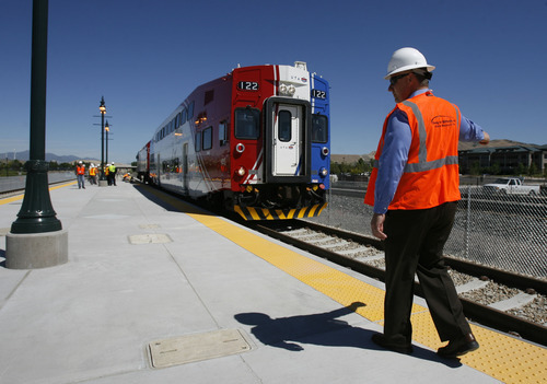 Francisco Kjolseth  |  The Salt Lake Tribune Todd Provost, senior project manager and engineer for Project Delivery, guides the first FrontRunner train as it arrives in Utah County at the Lehi Station on Monday, June 11, 2012, marking the beginning of the testing process of the new commuter rail line that links Provo to Salt Lake City.