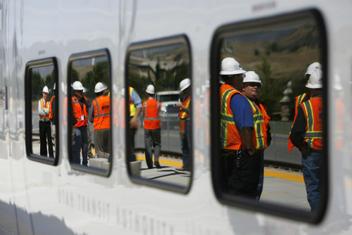 Francisco Kjolseth  |  The Salt Lake Tribune Crews welcome the first FrontRunner train as it arrives in Utah County at the Lehi Station on Monday, June 11, 2012, marking the beginning of the testing process of the new commuter rail line that links Provo to Salt Lake City.