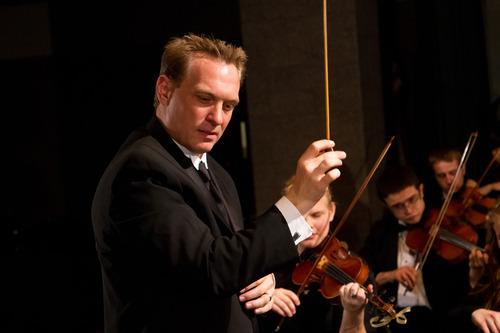 Kayson Brown, Director of the American Heritage Lyceum Philharmonic, conducting