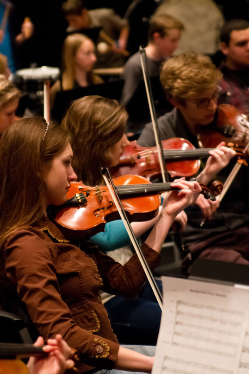 Violinists Kristy Duncan and McKenna Motto rehearsing with the American Heritage Lyceum Philharmonic in 2012. (Courtesy Pete Hansen)