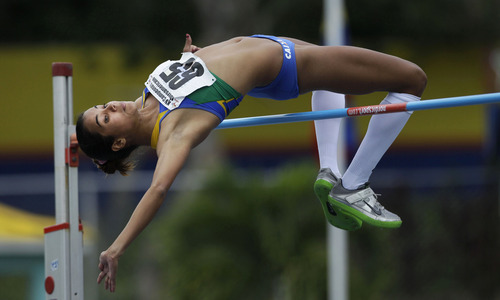 Aline Santos of Brazil clears the bar to win the silver in the women's high jump final event at the XV Ibero-American Athletics Championship in Barquisimeto, Venezuela, Friday, June 8, 2012. (AP Photo/Ariana Cubillos)