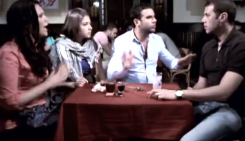 In this image made from video released by the Egyptian State TV and accessed Sunday, June 10, 2012, shows an actor portraying a foreigner, left, who is listening to three actors portraying Egyptians during a scene in a public service announcement in Cairo, Egypt. An Egyptian media official says authorities have pulled TV public service announcements that warned against talking to foreigners who may be spies after criticism that they fueled xenophobia. (AP Photo/Egyptian State TV via AP video) TV OUT, THE ASSOCIATED PRESS CANNOT INDEPENDENTLY VERIFY THE CONTENT, DATE, LOCATION OR AUTHENTICITY OF THIS MATERIAL