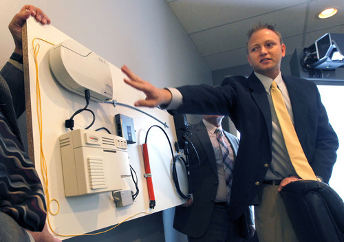 Al Hartmann  |  The Salt Lake Tribune   Utopia director of network engineering Roger Timmerman shows the company's fiber-optic hardware at their corporate office Tuesday June 12.  The company announced that the fiber-optic network will be increasing it's residential speed to 1 gigabit-per-second.    That's about 200 times faster than the typical broadband connection of 5 megabit per second.