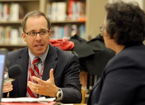 Stephen Holt  |  Special to The Tribune  Superintendent of the Canyons School District David Doty speaks to Rosa Salamanca, U.S. Department of Justice Conciliations Specialist during the Canyons School District council meeting Tuesday night in Brighton High School.