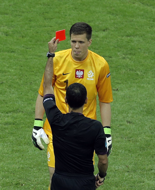 Poland goalkeeper Wojciech Szczesny, top, is given a red card during the Euro 2012 soccer championship Group A match between Poland and Greece in Warsaw, Poland, Friday, June 8, 2012. (AP Photo/Gero Breloer)