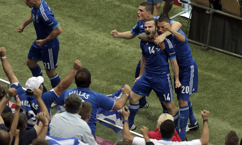 Greece's Dimitris Salpigidis, second right, reacts after he scored his side's first goal during the Euro 2012 soccer championship Group A match between Poland and Greece in Warsaw, Poland, Friday, June 8, 2012. (AP Photo/Gero Breloer)