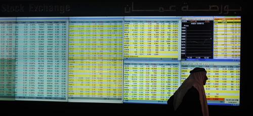A Jordanian investor at the Amman Exchange Market looks at stocks in Amman, Jordan, Wednesday, June 13, 2012. (AP photo/Mohammad Hannon)