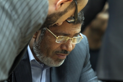 In this Sunday, June 3, 2012, photo, Muslim Brotherhood presidential candidate Mohammed Morsi confers with an aide during a meeting with relatives, unseen, of those killed and injured during last year's revolution that forced former Egyptian president Hosni Mubarak from power, in Cairo, Egypt. The Muslim Brotherhood has energized its powerful electoral machine, trying to rally the public behind its candidate for president in a tough race against former prime minister Ahmed Shafiq. (AP Photo/Ahmed Gomaa)