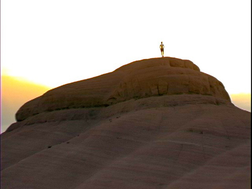 Filmmaker Lindsay Jaeger atop a red-rock formation in Escalante, Utah, near the end of her film