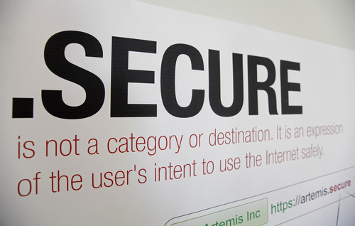 In this photo taken Friday, June 8, 2012, a domain name poster is displayed at the offices of Artemis Internet, an NCC Group Company in San Francisco. Some 2,000 proposals have been submitted as part of the largest expansion of the Internet address system since its creation in the 1980s. These suffixes would rival