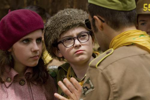 Suzy (Kara Hayward, left) and Sam (Jared Gilman) hatch an escape plot with an older scout (Jason Schwartzman) in Wes Anderson's