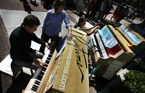 Scott Sommerdorf  |  The Salt Lake Tribune              Josh Wright, left, and Sarah Shipp play a duet outside the Utah Museum of Contemporary Art as the museum unveiled their public-art exhibit,