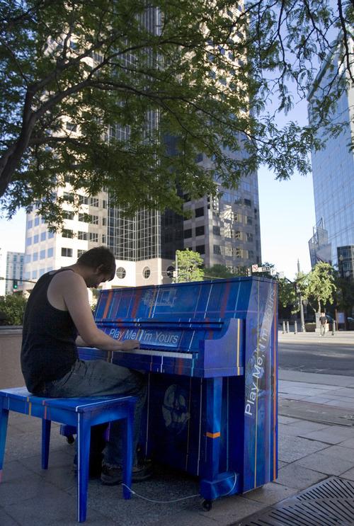 Kim Raff | The Salt Lake Tribune Christopher Goudge plays a piano at Jones Waldo downtown as part of Utah Museum of Contemporary Art's
