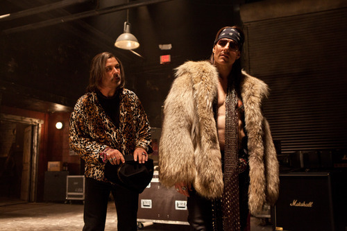 This film image released by Warner Bros. Pictures shows  Alec Baldwin as Dennis Dupree, left, and Tom Cruise as Stacee Jaxx in New Line Cinema's rock musical